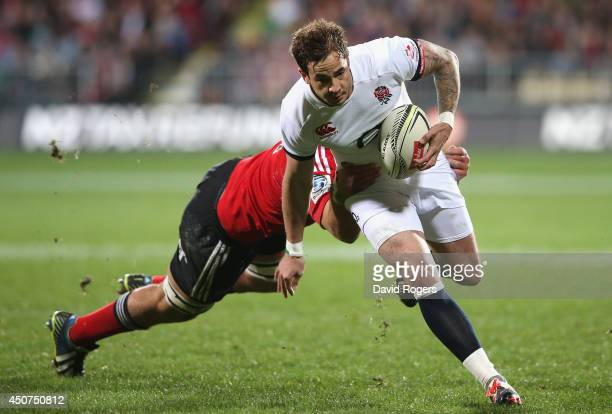 Danny Cipriani of England breaks past Joel Everson during the match between the Crusaders and England at the AMI Stadium on June 17, 2014 in...