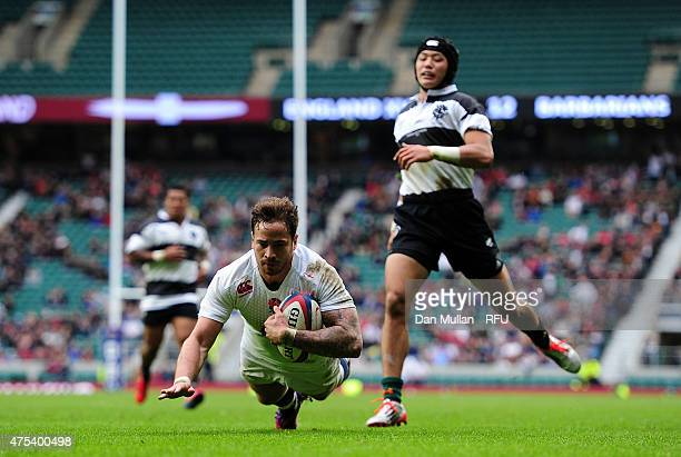 Danny Cipriani of England dives over for a try during the Rugby Union International Match between England and The Barbarians at Twickenham Stadium on...