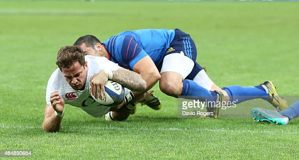 Danny Cipriani of England dives over to score a try during the International match between France and England at Stade de France on August 22, 2015...