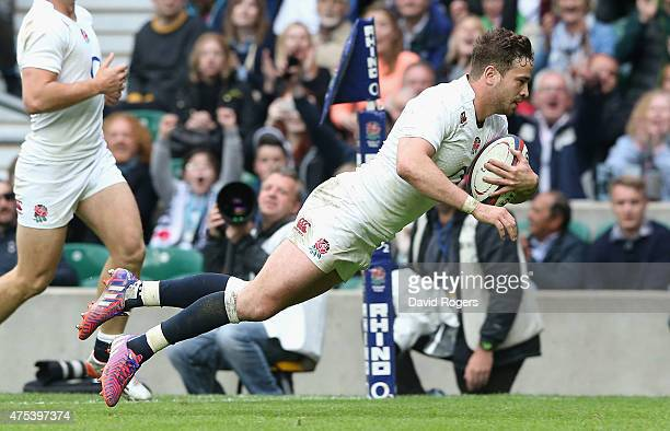 Danny Cipriani of England dives over to score his second try durng the Rugby International match between England and the Barbarians at Twickenham...