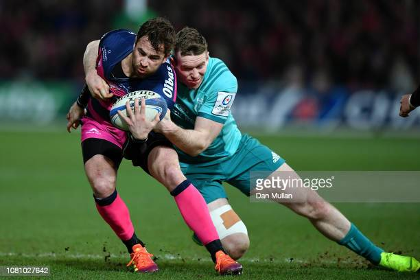 Danny Cipriani of Gloucester is tackled by Chris Farrell of Munster during the Champions Cup match between Gloucester Rugby and Munster Rugby at...