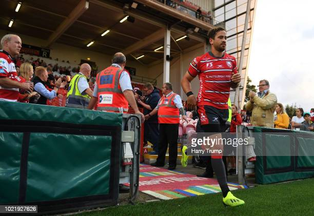 Danny Cipriani of Gloucester Rugby makes his way onto the field during the Pre Season Friendly match between Gloucester Rugby and Dragons at...