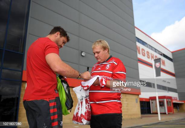 Danny Cipriani of Gloucester Rugby signs an autograph for a fan prior to the start during the Pre Season Friendly match between Gloucester Rugby and...