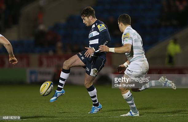 Danny Cipriani of Sale Sharks attempts to clear the ball away from Fergus Mulchrone of London Irish during the Aviva Premiership match between Sale...