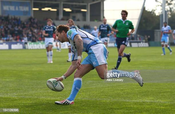Danny Cipriani of Sale Sharks touches the ball down to score his try during the Heineken Cup Pool 6 match between Sale Sharks and Cardiff Blues at...
