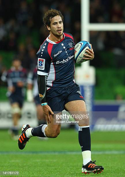 Danny Cipriani of the Rebels appears to grab at his hamstring on his way to scoring during the round five Super Rugby match between the Melbourne...