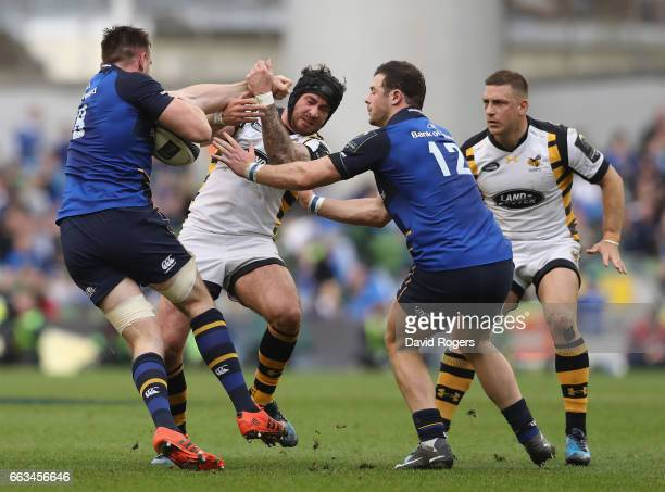 Danny Cipriani of Wasps is tackled by Jack Conan and Robbie Henshaw during the European Rugby Champions Cup match between Leinster and Wasps at the...