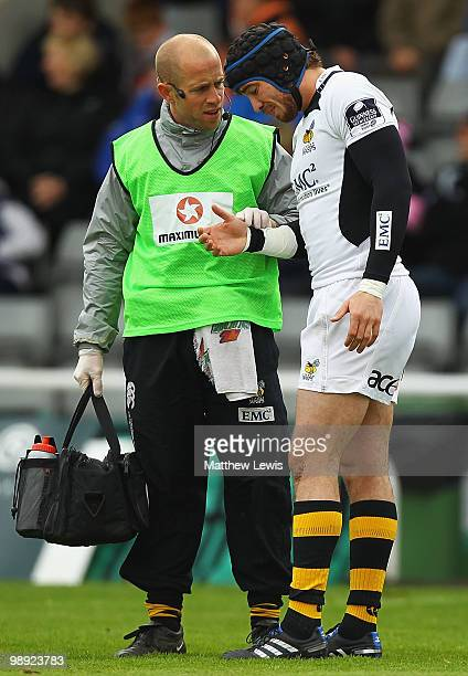 Danny Cipriani of Wasps looks on, as he receives treatment to his hand during the Guinness Premiership match between Newcastle Falcons and London...