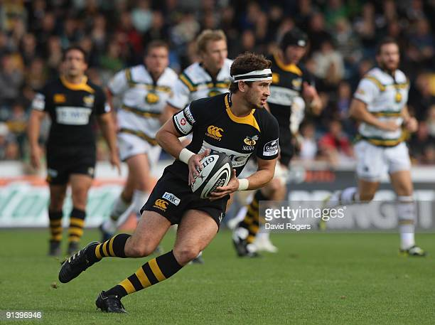 Danny Cipriani of Wasps moves away with the ball during the Guinness Premiership match between London Wasps and Northampton Saints at Adams Park on...