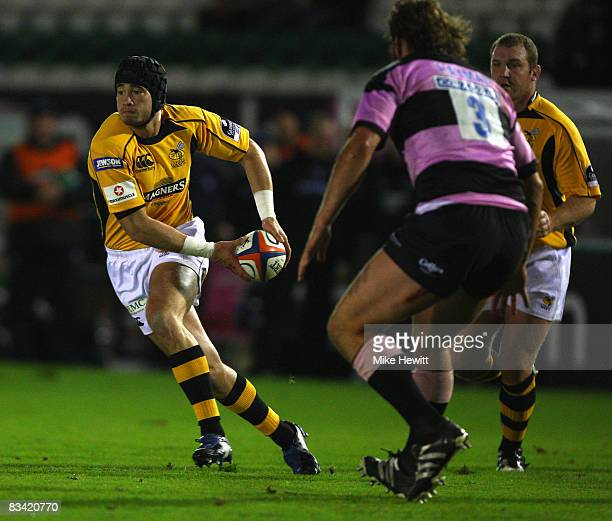 Danny Cipriani of Wasps takes on Carl Hayman of Newcastle Falcons during the EDF Energy Cup match between Newcastle Falcons and London Wasps at...