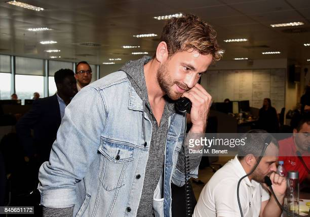 Danny Cipriani representing OASIS makes a trade at BGC Charity Day on September 11 2017 in Canary Wharf London United Kingdom