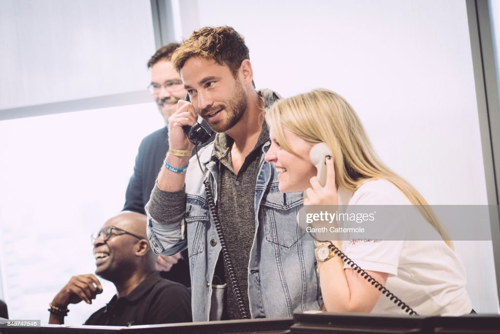 Danny Cipriani (L), representing Oasis, makes a trade at BGC Charity Day on September 11, 2017 in London, United Kingdom.