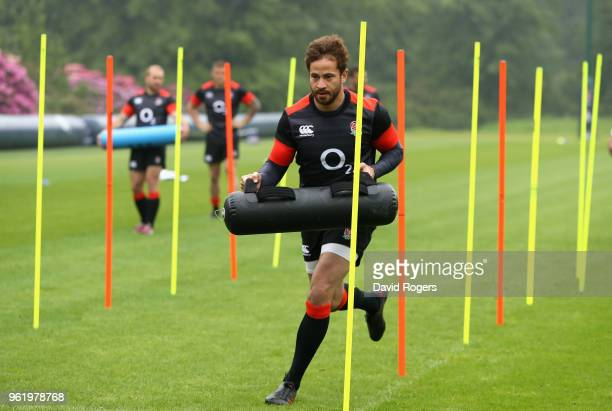 Danny Cipriani warms up carring a weight bag during the England training session held at Pennyhill Park on May 24 2018 in Bagshot England