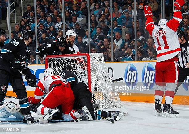 Danny Cleary and Justin Abdelkader of the Detroit Red Wings celebrate Cleary's third period goal against Logan Couture, Devin Setoguchi, and Niclas...