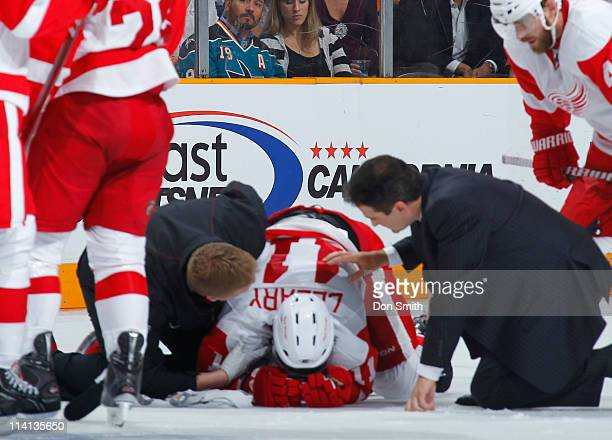 Danny Cleary of the Detroit Red Wings is tended to by trainers after a collision with his own teammate against the San Jose Sharks in Game Seven of...