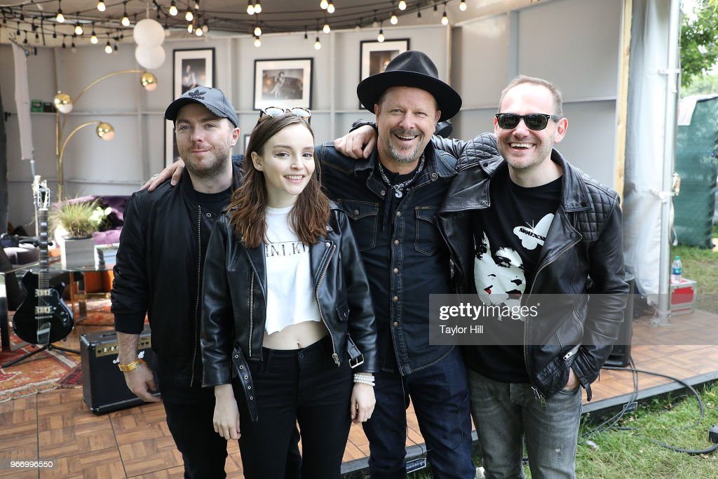 Danny Clinch and Chvrches attend Day 3 of the 2018 Governors Ball Music Festival at Randall's Island on June 3, 2018 in New York City.