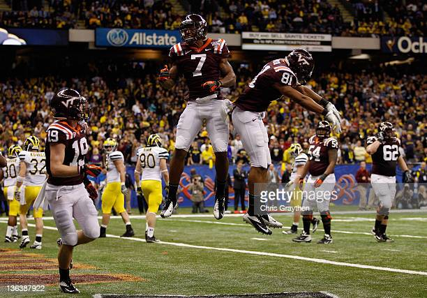 Danny Coale Marcus Davis and Jarrett Boykin of the Virginia Tech Hokies celebrate after Davis caught a 2point conversion in the fourth quarter...