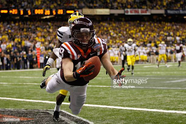 Danny Coale of the Virginia Tech Hokies fails to catch a potential go ahead touchdown late in the game against the Michigan Wolverines during the...