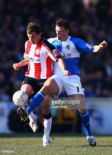 Danny Coles of Bristol Rovers challenges with Marek Saganowski of Southampton during the FA Cup sponsored by Eon Fifth Round match between Bristol...