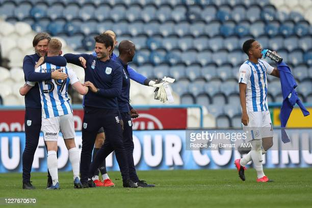 Danny Cowley head coach / manager of Huddersfield Town and Nicky Cowley the assistant head coach / manager of Huddersfield Town celebrate with Lewis...