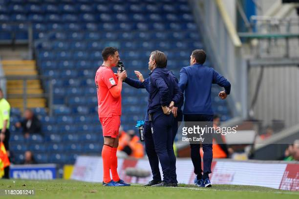 Danny Cowley Manager / Head Coach of Huddersfield Town and Nicky Cowley of Huddersfield Town talk to Tommy Elphick of Huddersfield Town during the...