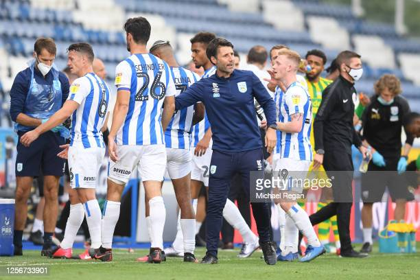 Danny Cowley Manager of Huddersfield Town speaks to his players during the drinks break during the Sky Bet Championship match between Huddersfield...