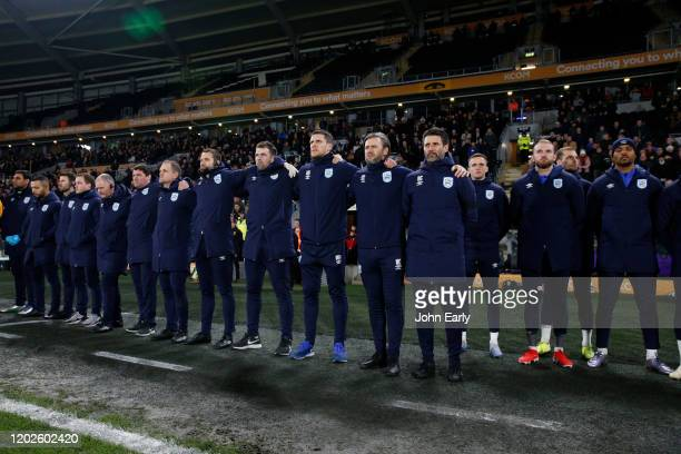Danny Cowley Manager of Huddersfield Town stands with his coaching staff for a minute's silence in memory of Jordan Sinnott a previous Town player...