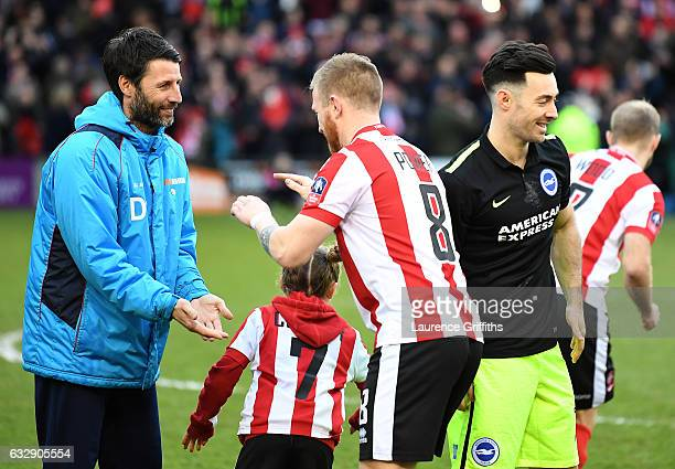 Danny Cowley manager of Lincoln City and Alan Power of Lincoln City speak during the Emirates FA Cup Fourth Round match between Lincoln City and...