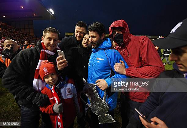 Danny Cowley manager of Lincoln City is surrounded by supporters after his side's 31 win in the Emirates FA Cup Fourth Round match between Lincoln...