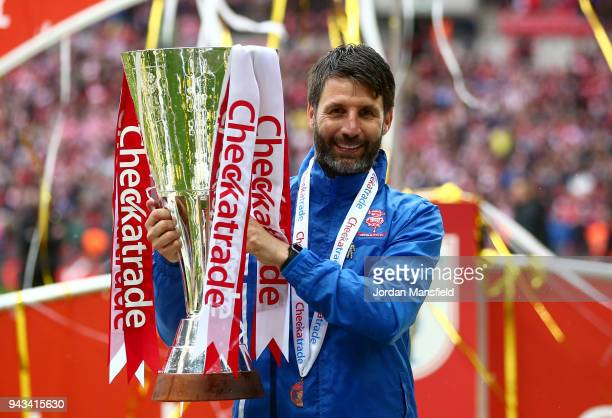 Danny Cowley manager of Lincoln City lifts the trophy after victory during the Checkatrade Trophy Final between Shrewsbury Town and Lincoln City at...
