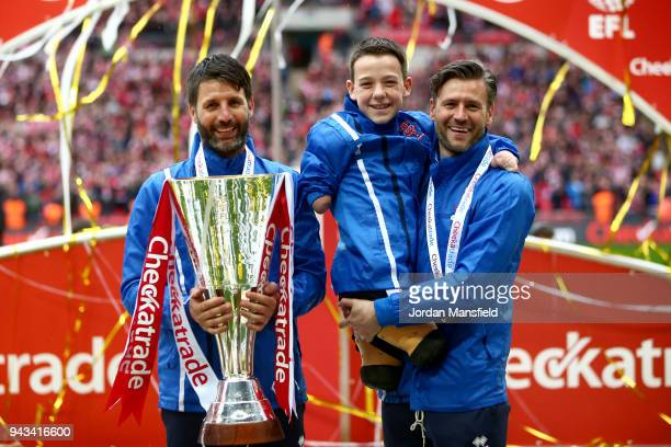 Danny Cowley manager of Lincoln City Nicky Cowley assistant manager lift the trophy after victory during the Checkatrade Trophy Final between...