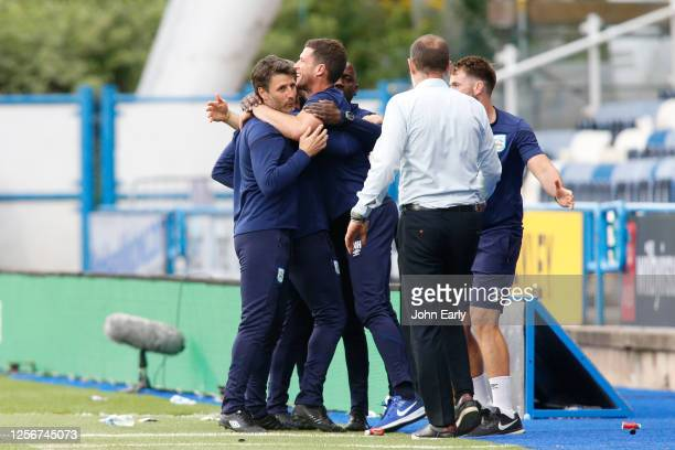 Danny Cowley the Manager of Huddersfield Town and his coaching team celebrate during the Sky Bet Championship match between Huddersfield Town and...