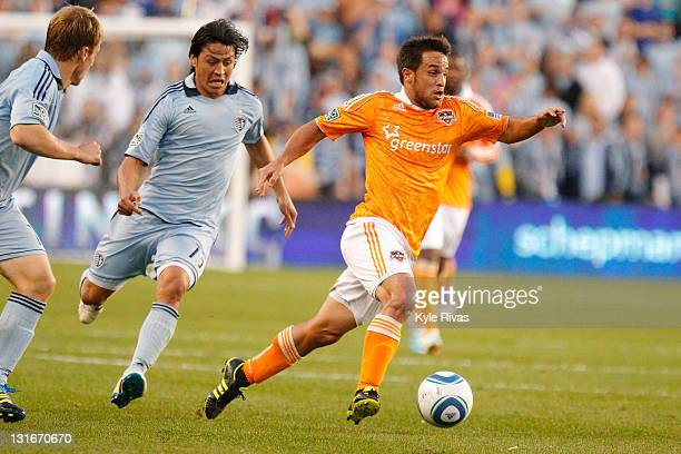 Danny Cruz of the Houston Dynamo pushes the ball up the field in the first half during the MLS Eastern Conference Championship match at Livestrong...