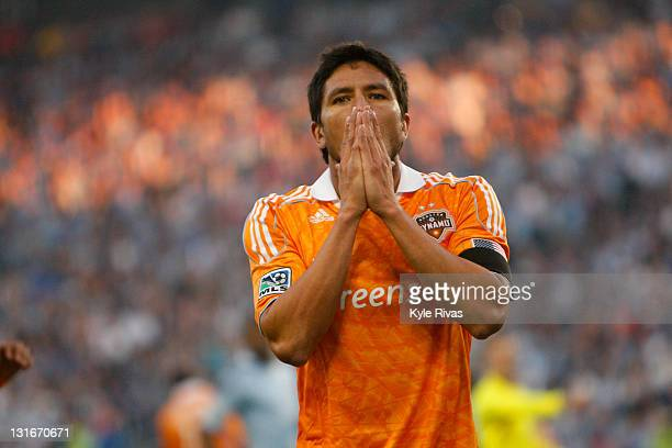 Danny Cruz of the Houston Dynamo reacts to his shot being block by Jimmy Nielsen of Sporting Kansas City in the first half during the MLS Eastern...