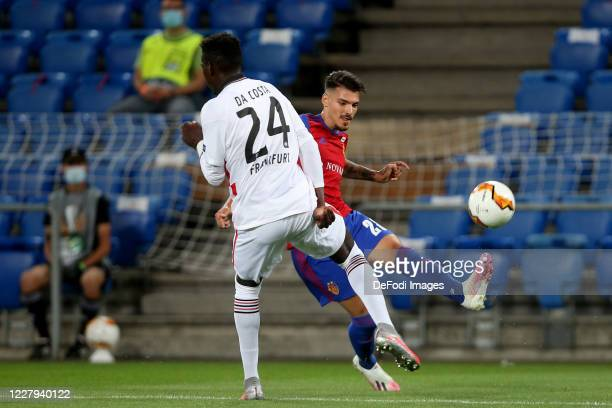 Danny da Costa of Eintracht Frankfurt and Raoul Petretta of FC Basel 1893 battle for the ball during the UEFA Europa League round of 16 second leg...
