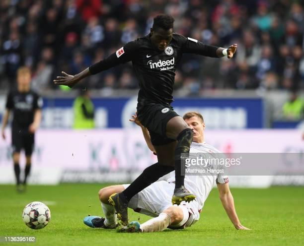 Danny da Costa of Eintracht Frankfurt is tackled by Patrick Erras of Nurnberg during the Bundesliga match between Eintracht Frankfurt and 1 FC...