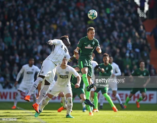 Danny da Costa of Frankfurt and Niklas Moisander of Bremen battle for the ball during the Bundesliga match between Werder Bremen and Eintracht...