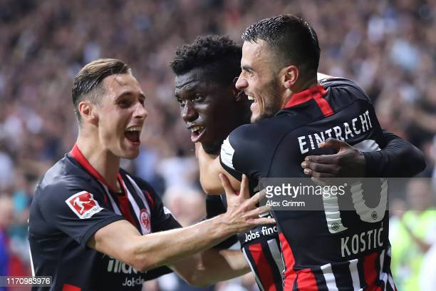 Danny da Costa of Frankfurt celebrates his team's third goal with team mates Filip Kostic and Dominik Kohr during the second leg of the UEFA Europa...