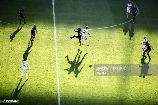 Danny da Costa of Frankfurt jumps for a header with Florian Neuhaus of Moenchengladbach during the Bundesliga match between Eintracht Frankfurt and...
