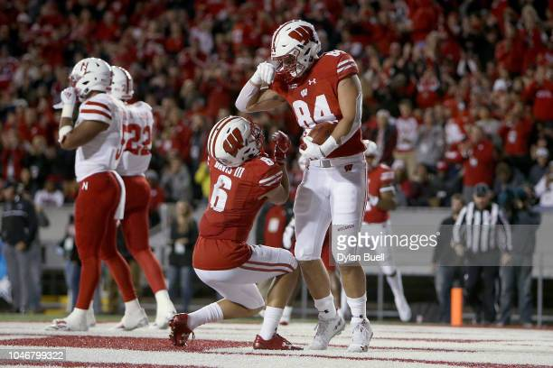 Danny Davis III and Jake Ferguson of the Wisconsin Badgers celebrate after Ferguson scored a touchdown in the second quarter against the Nebraska...