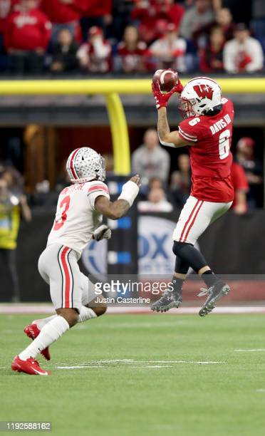 Danny Davis III of the Wisconsin Badgers catches a pass in the Big Ten Championship game against the Ohio State Buckeyes at Lucas Oil Stadium on...