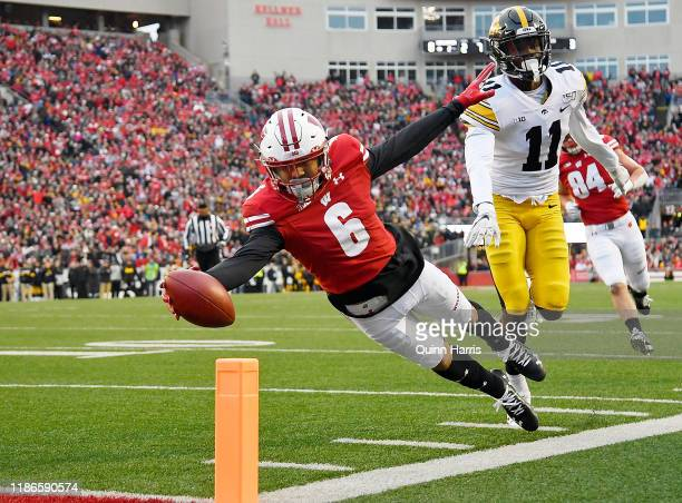 Danny Davis III of the Wisconsin Badgers dives to score a touchdown in the first half against the Iowa Hawkeyes at Camp Randall Stadium on November...