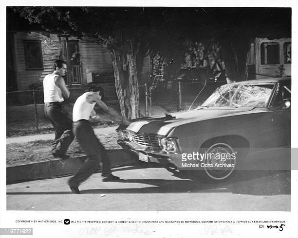 Danny De La Paz and Richard Yniguez smash up car in a scene from the film 'Boulevard Nights' 1979