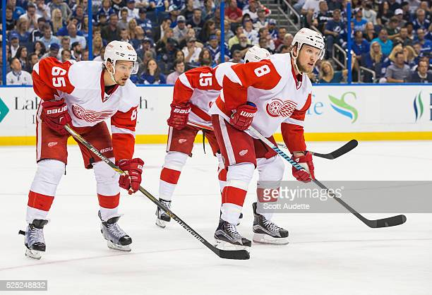 Danny DeKeyser and Justin Abdelkader of the Detroit Red Wings skate against the Tampa Bay Lightning during Game Five of the Eastern Conference First...