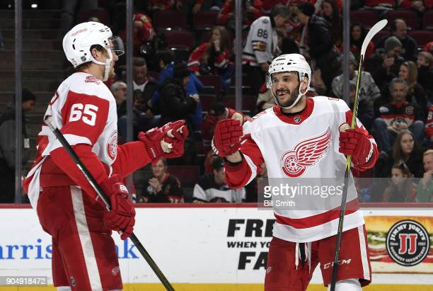 Danny DeKeyser and Martin Frk of the Detroit Red Wings celebrate after defeating the Chicago Blackhawks 40 at the United Center on January 14 2018 in...