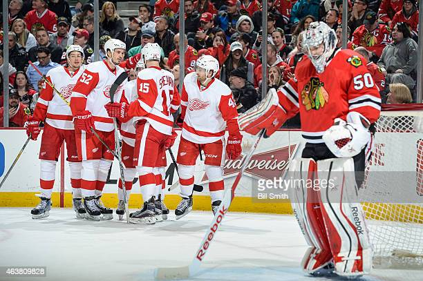 Danny DeKeyser Jonathan Ericsson Riley Sheahan and Darren Helm of the Detroit Red Wings celebrate with Tomas Tatar after scoring on goalie Corey...