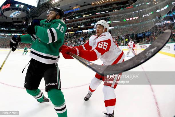 Danny DeKeyser of the Detroit Red Wings checks Martin Hanzal of the Dallas Stars in the first period at American Airlines Center on October 10 2017...