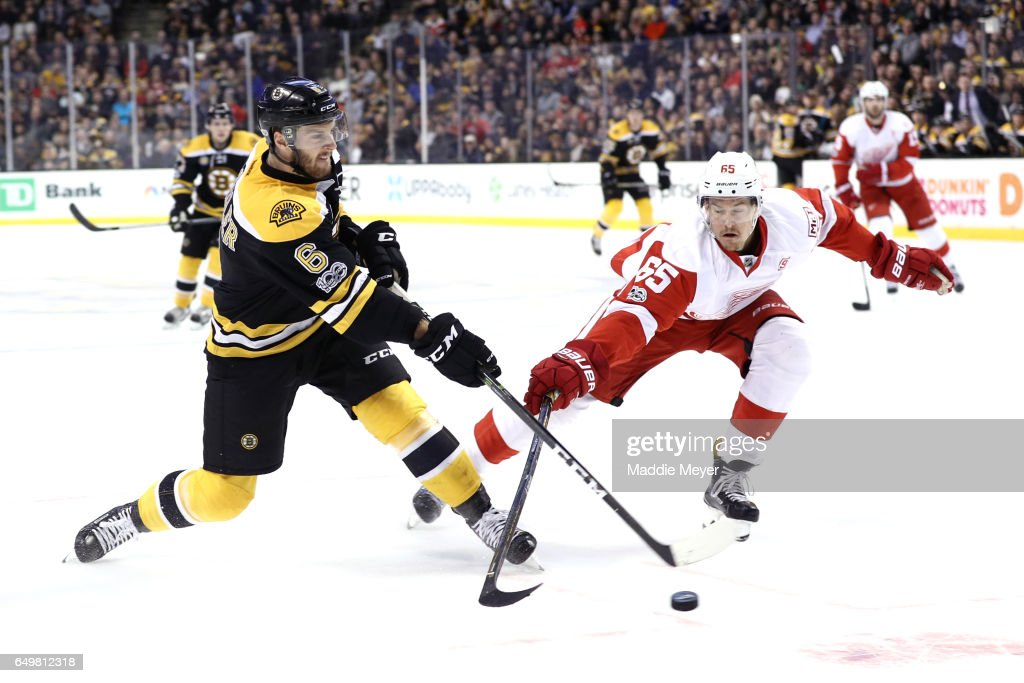 Danny DeKeyser #65 of the Detroit Red Wings defends Colin Miller #6 of the Boston Bruins during the first period at TD Garden on March 8, 2017 in Boston, Massachusetts.