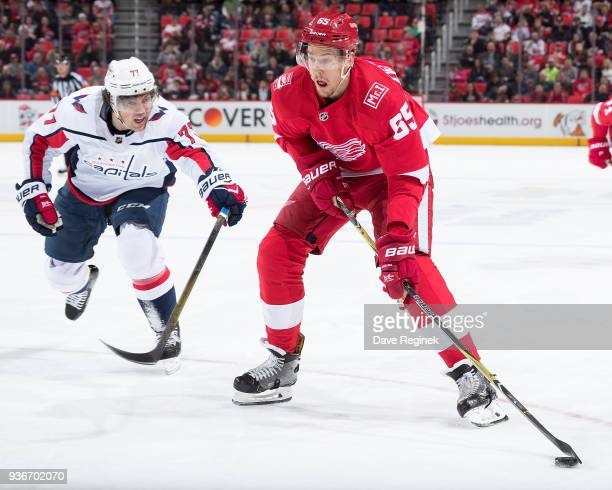 Danny DeKeyser of the Detroit Red Wings looks to shoot the puck as TJ Oshie of the Washington Capitals reaches in front during an NHL game at Little...