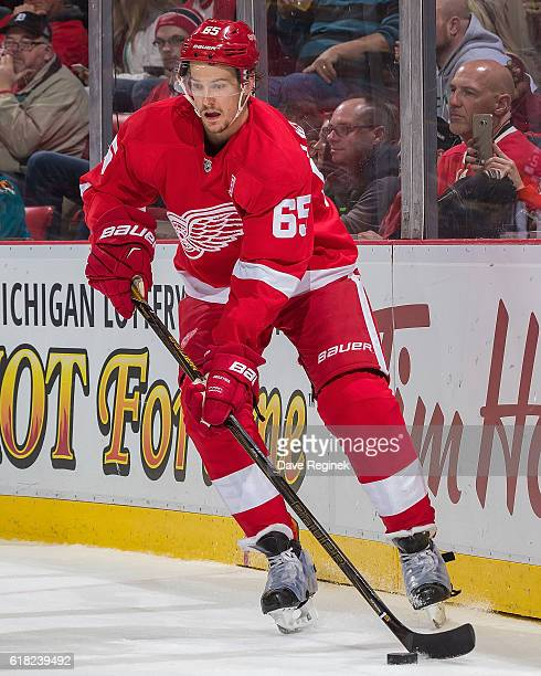 Danny DeKeyser of the Detroit Red Wings skates around the net with the puck during an NHL game against San Jose Sharks at Joe Louis Arena on October...
